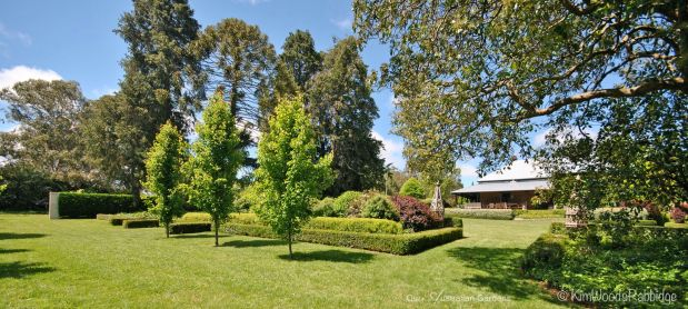 Hedges trimmed immaculately at various levels add depth and perspective.