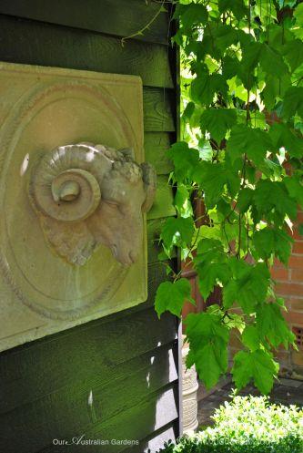 A decorative ram's head relief.