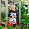 Helen Dillon ouitside her greenhouse