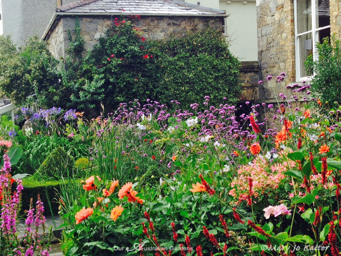 Muted stone is the perfect background to the vivid colour in the garden