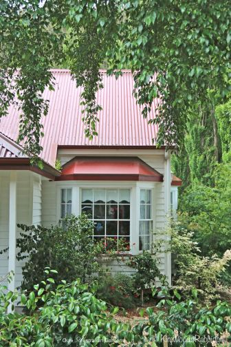 Gables, verandas and oriel windows contribute to the cottage's appeal.