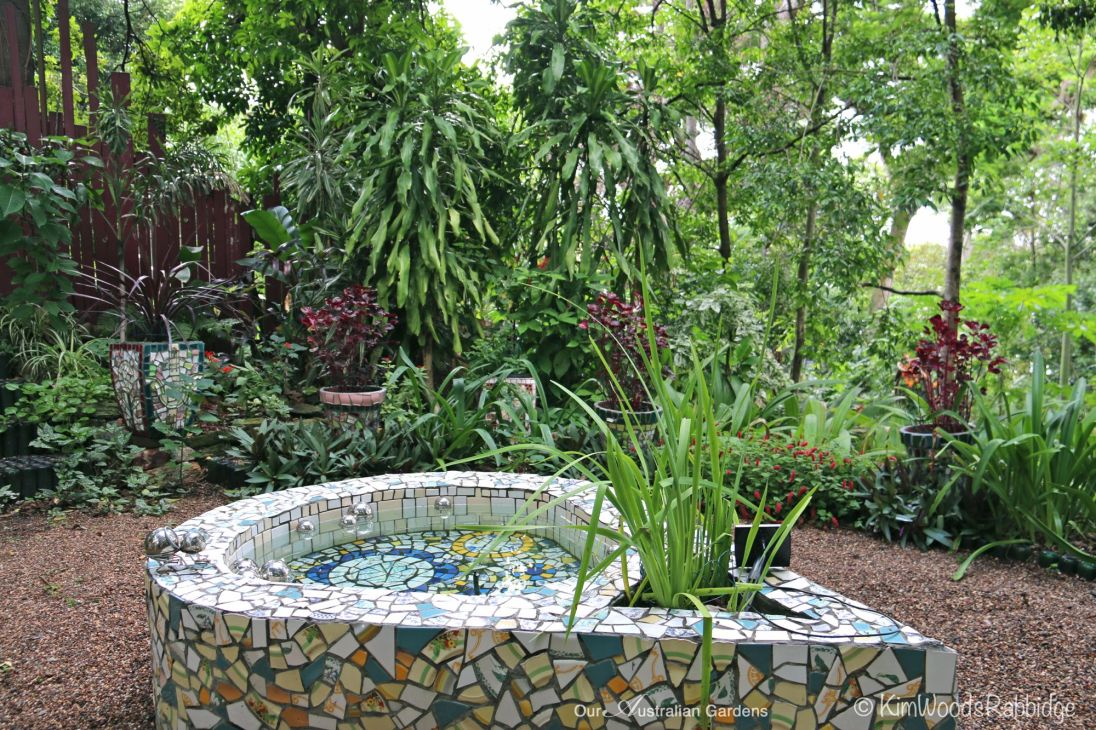 The tear-shaped pond is the central feature in the Hidden Garden.