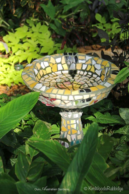 Mosaic birdbath.